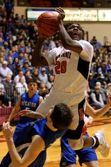 Burkburnett's Kendarius Horton gets the layup and the foul Tuesday evening as the Burkburnett Bulldogs took on the Decatur Eagles at DL Ligon Coliseum at MSU in the area  playoff game.