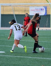 Old High senior Alyssa Salinas shakes loose Rider's Sola Fiorentino. The Coyotes lost to the Raiders 2-0 at Memorial Stadium Tuesday, February 26, 2019.