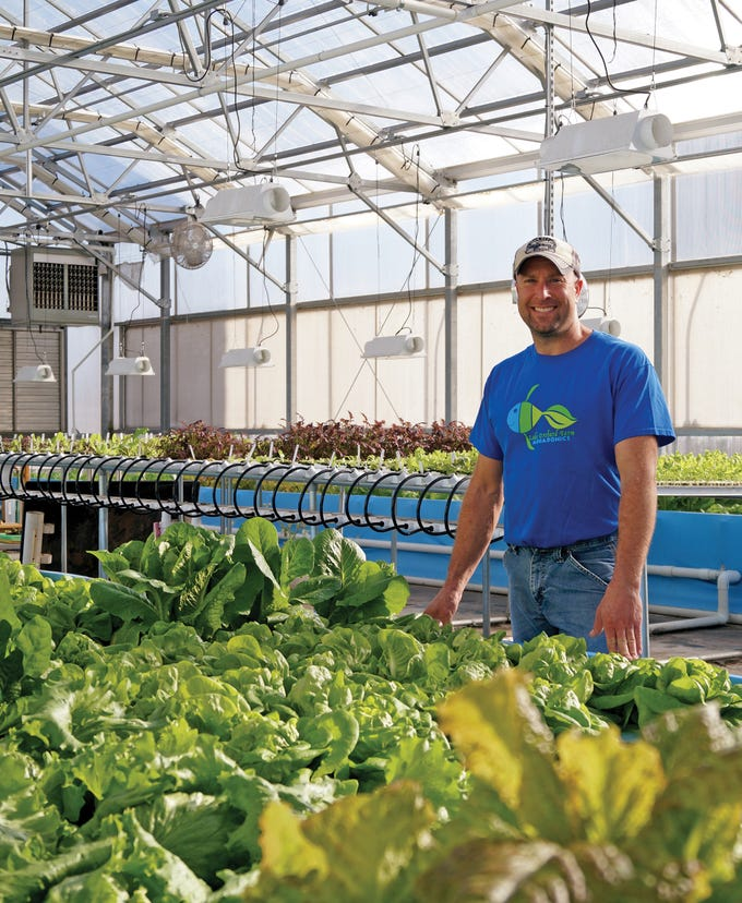 Sixth generation farmer, Nate Calkins, used to work with cattle but now he spends his days handling a new 'stock' as co-owner of Lake Orchard Farm Aquaponics.