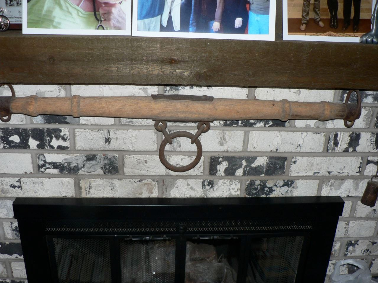 A neck yoke used by a team of horses to hold the wagon tongue. I kept it mounted on the fireplace as a souvenir of my youth.
