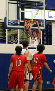Philo's AJ Clayton dunks against Minerva Tuesday night at the Power Plant.