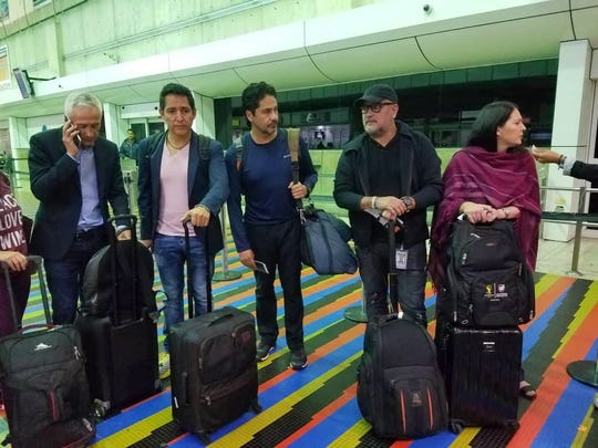 A handout picture from the Univision team in Venezuela, shows Jorge Ramos (left) and his crew moments before being deported from the International Airport of Maiquetia, Venezuela on Feb. 26, 2019. The team was detained during an interview with Nicolas Maduro the day before.