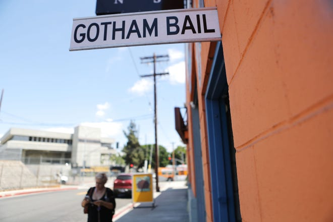 A sign advertises a bail bond company located near two jails in Los Angeles.