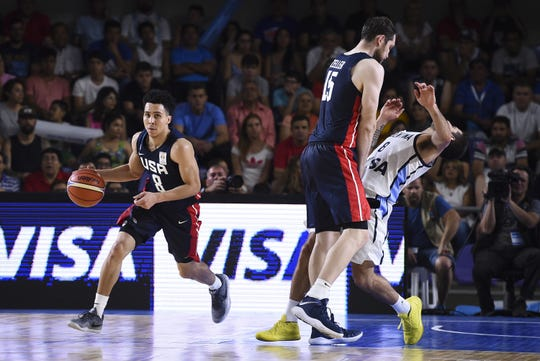 Travis Trice of USA dribbles the ball.