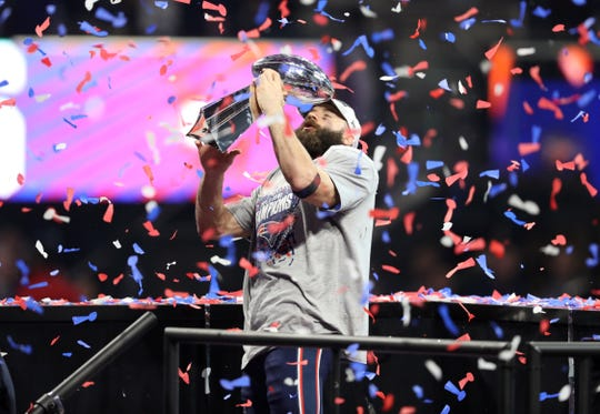 Patriots wide receiver Julian Edelman celebrates with the Vince Lombardi Trophy after winning Super Bowl LIII against the Los Angeles Rams at Mercedes-Benz Stadium.