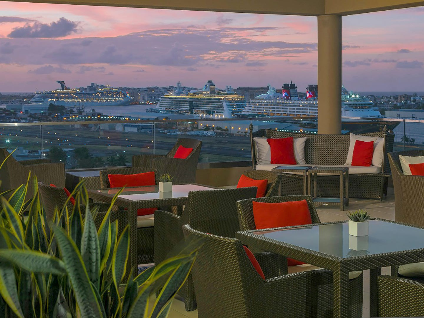 The rooftop pool bar at Sheraton Puerto Rico is the best spot to watch cruise ships chug along the bay.