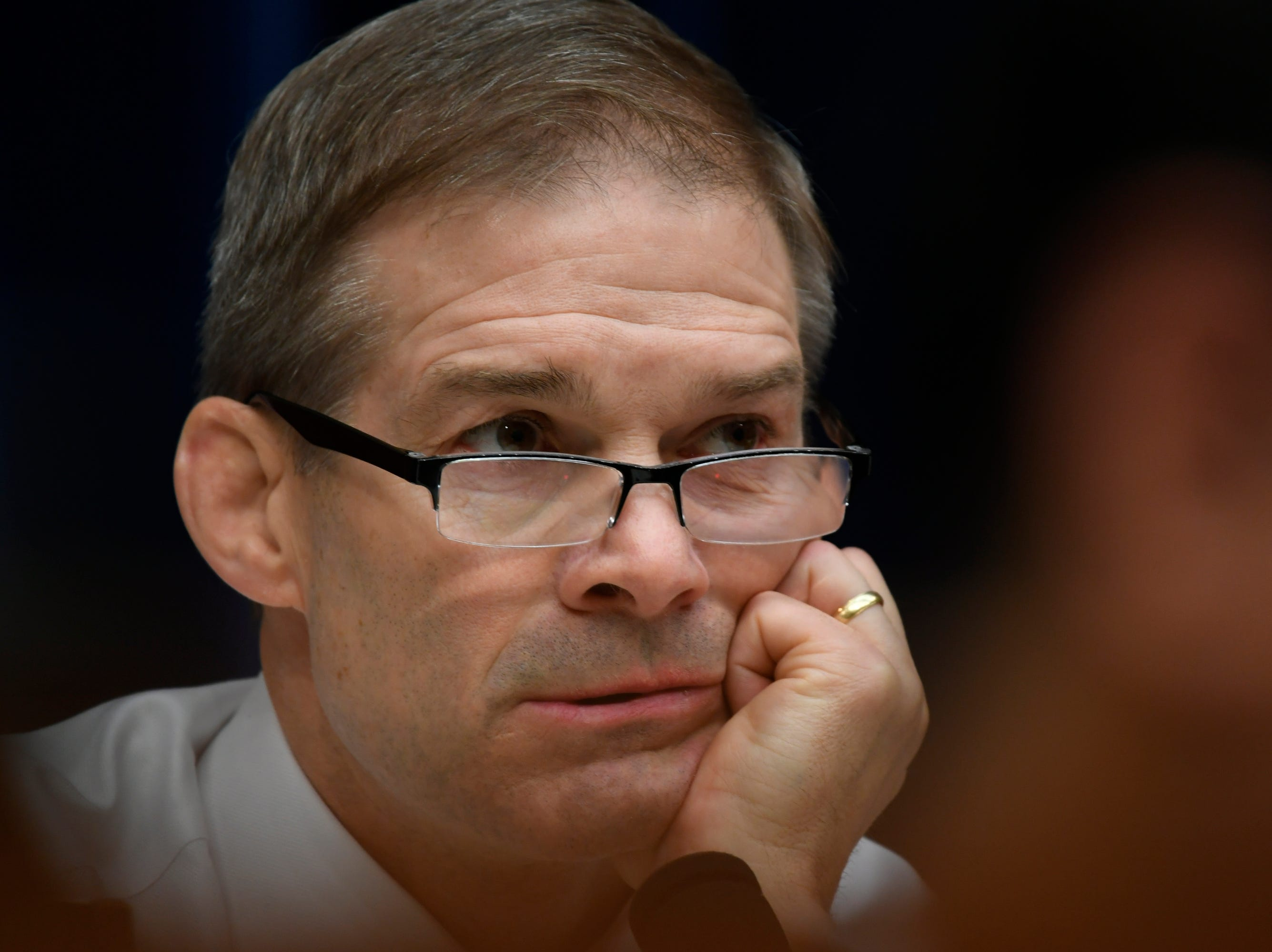 House Oversight and Reform Committee Ranking Member Jim Jordan, R-Ohio listens at the Michael Cohen hearing. Michael Cohen, President Donald Trump's longtime personal attorney, testifies before the House Committee on Oversight and Reform on Feb. 27, 2019 in Washington.