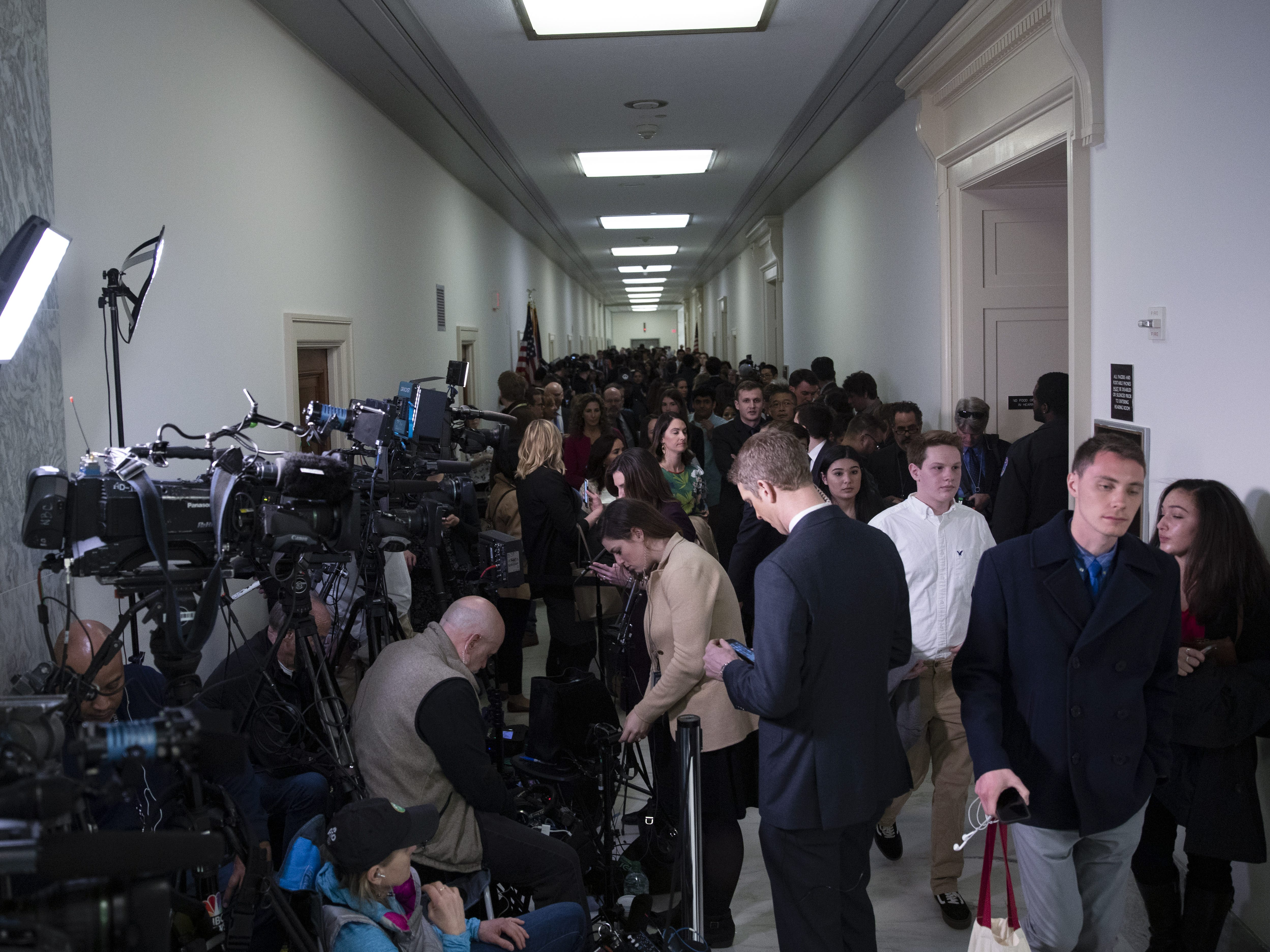 Media and guests pack the area outside the hearing where Michael Cohen, former attorney and fixer for President Donald Trump is testifying before the House Oversight Committee on in Washington, DC.
