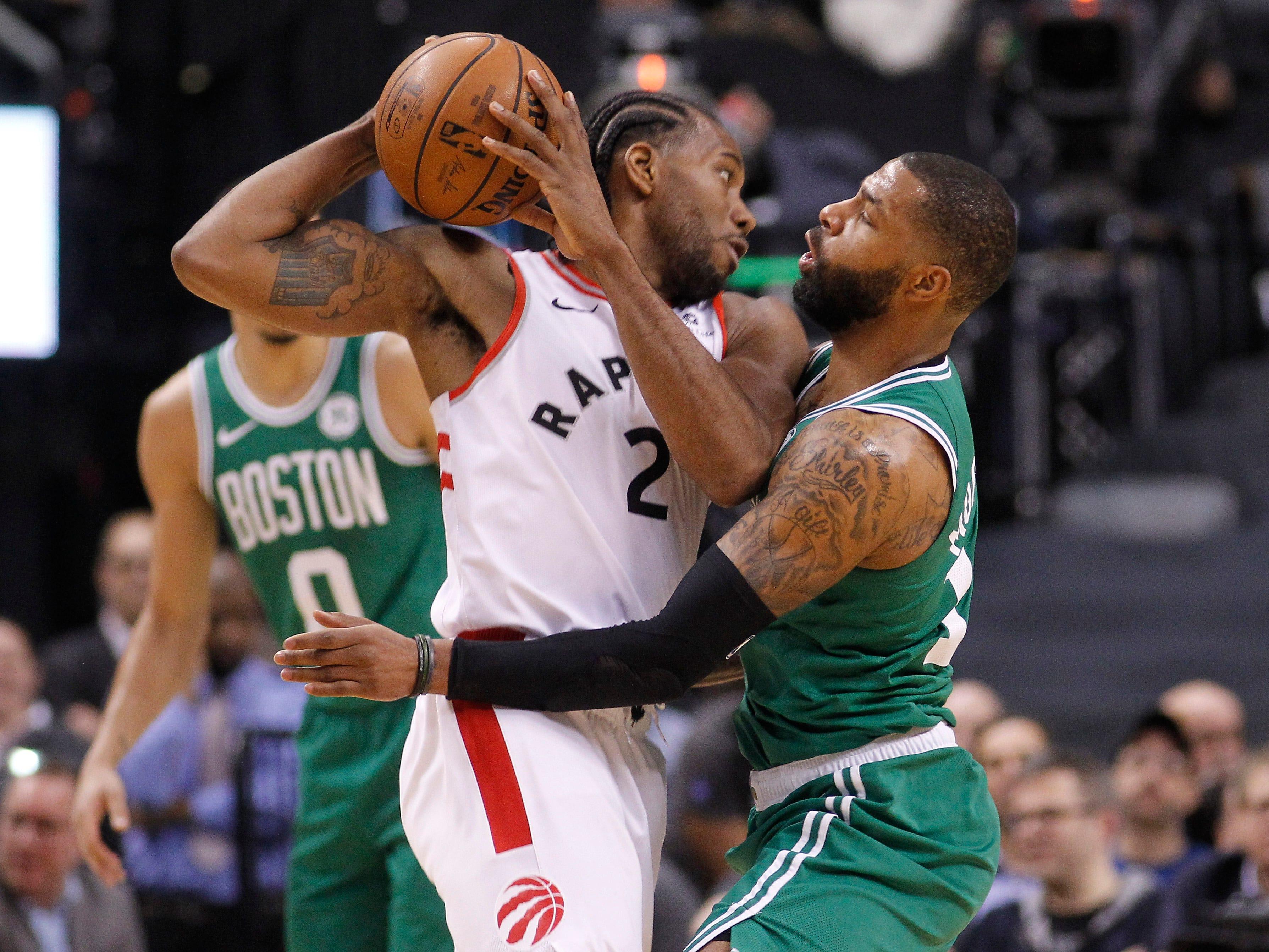 Feb. 26: Boston Celtics forward Marcus Morris pressures Toronto Raptors forward Kawhi Leonard at Scotiabank Arena. Toronto defeated Boston, 118-95.