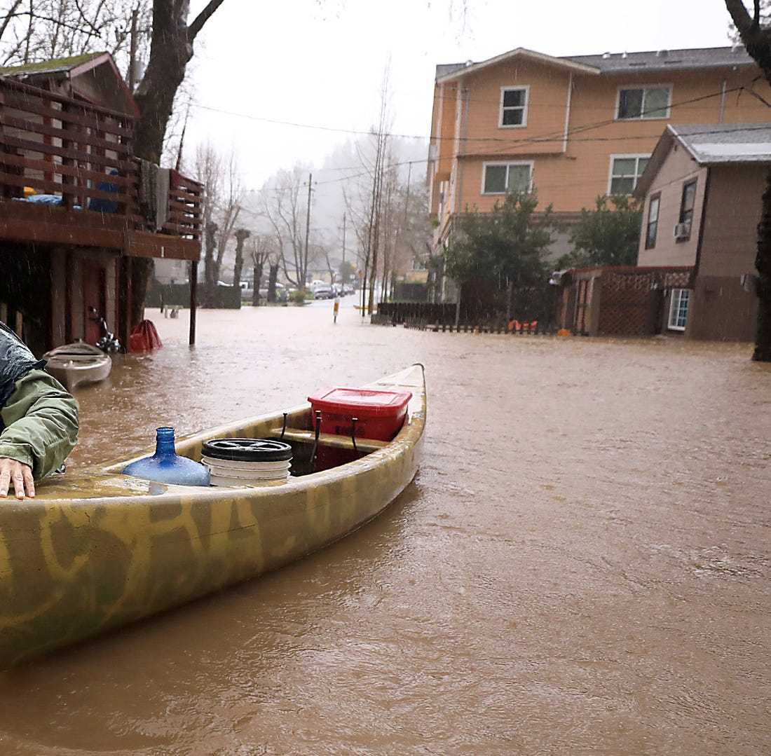 Hundreds flee as record rainfall swamps northern California, but thousands refuse to leave