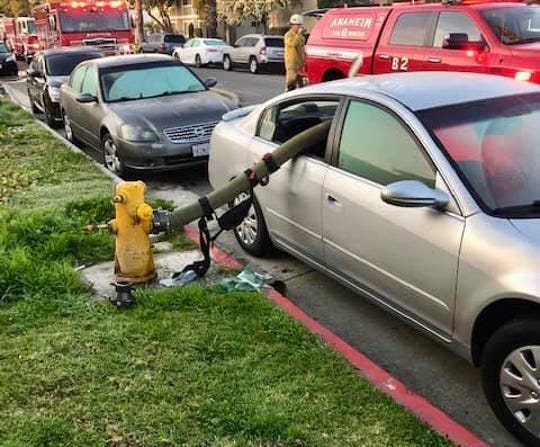 The Anaheim Fire & Rescue Department tweeted a warning to drivers on Feb. 26: a series of photos showing a fire hose strung through the back seat of a car that was parked next to a fire hydrant.