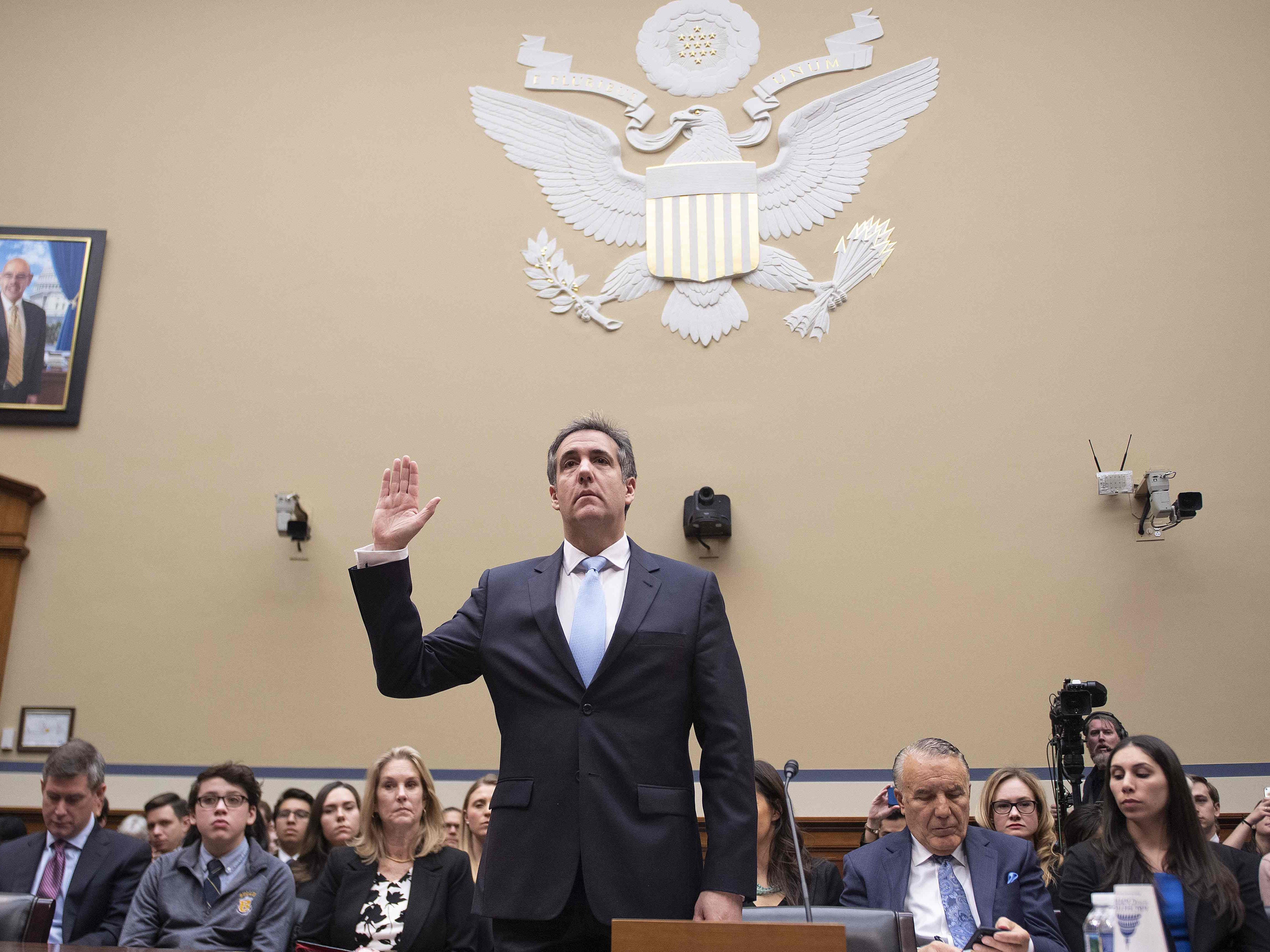 Michael Cohen, US President Donald Trump's former personal attorney, is sworn in to testify before the House Oversight and Reform Committee in the Rayburn House Office Building on Capitol Hill in Washington, DC on Feb. 27, 2019.
