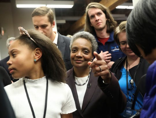 Mayoral candidate Lori Lightfoot and her daughter Vivian Lightfoot appear with supporters at EvolveHer in Chicago Tuesday, Feb. 26, 2019. Former federal prosecutor Lightfoot, who could become the first African-American woman to lead the nation's third-largest city, was the top vote-getter in a field of 14 that included a member of the Daley family that has dominated Chicago politics for much of the last six decades.