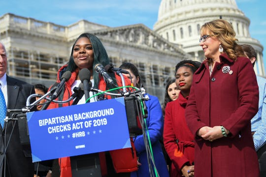 Audrey Wright, a high school junior from Chicago and the current president of the Peace Warriors, a student-based national youth movement advocating for stricter gun control, speaks alongside former Congresswoman Gabrielle Giffords Feb. 26, 2019.