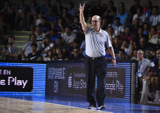 Jeff Van Gundy gestures during a match between Argentina and USA.