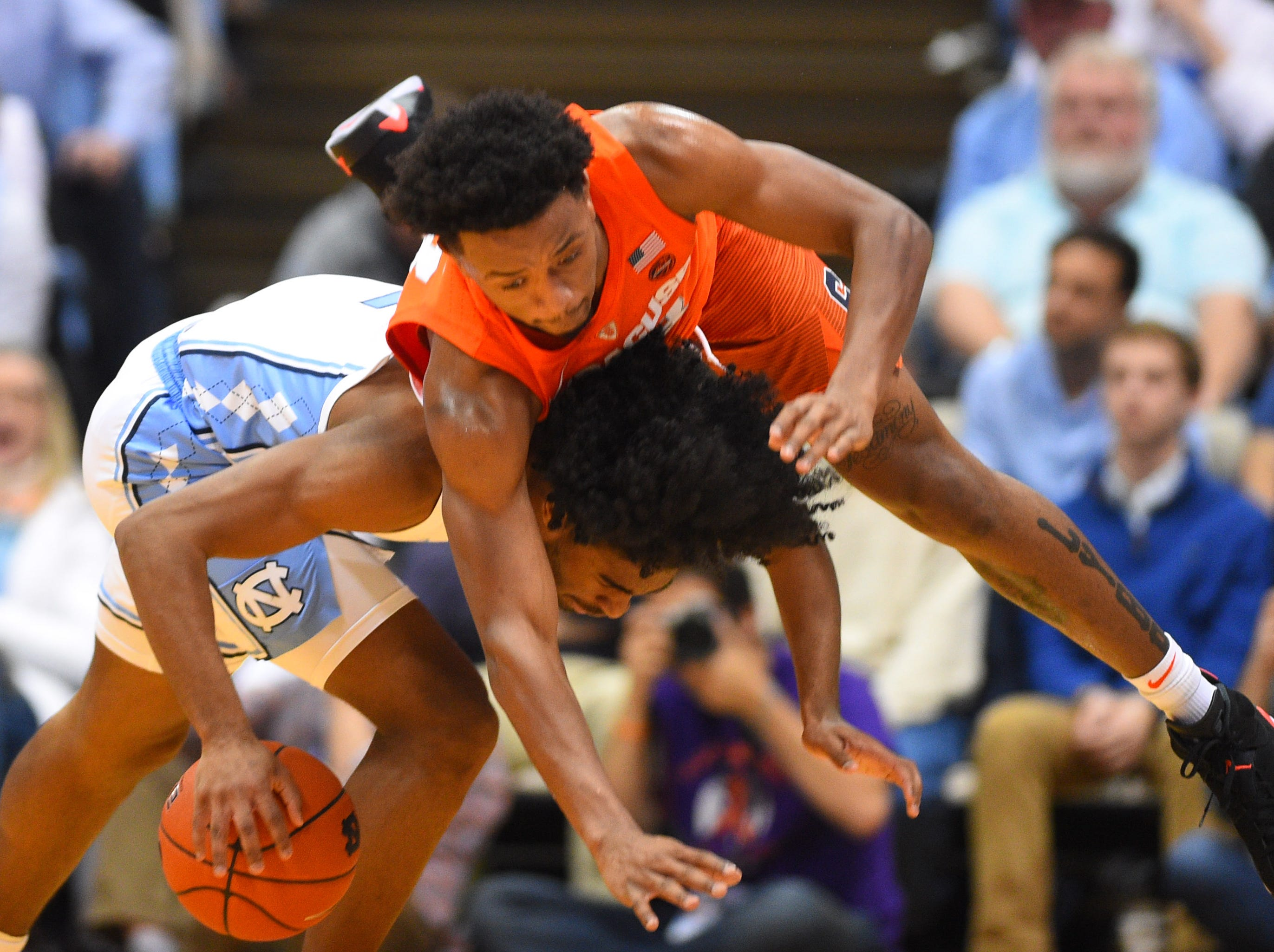 Feb. 26: Syracuse Orange forward Elijah Hughes (33) gets tangled up with North Carolina Tar Heels guard Coby White (2) in the first half at Dean E. Smith Center.