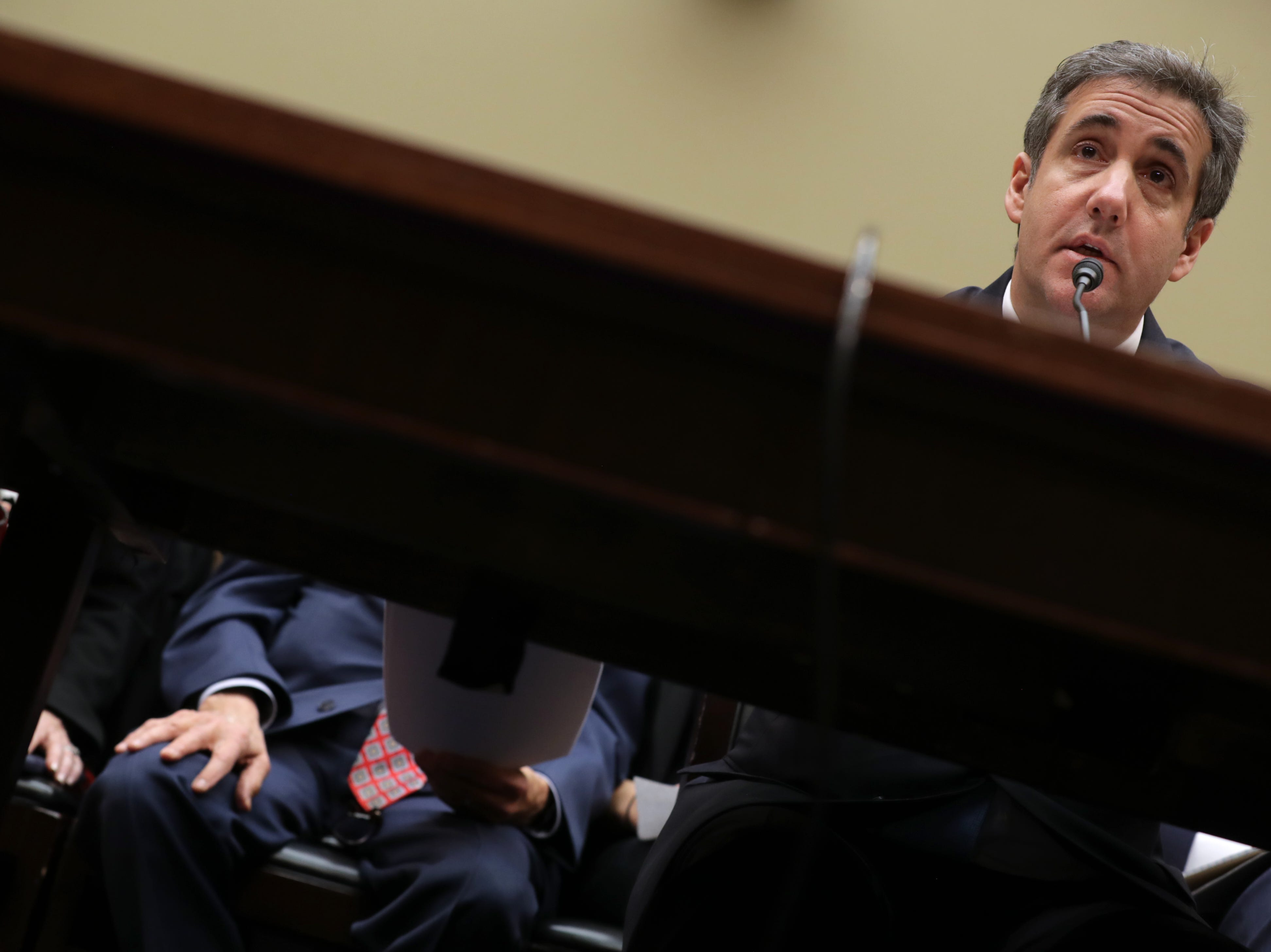 Michael Cohen, former attorney and fixer for President Donald Trump testifies before the House Oversight Committee on Capitol Hill Feb. 27, 2019 in Washington, DC. Last year Cohen was sentenced to three years in prison and ordered to pay a $50,000 fine for tax evasion, making false statements to a financial institution, unlawful excessive campaign contributions and lying to Congress as part of special counsel Robert Mueller's investigation into Russian meddling in the 2016 presidential elections.