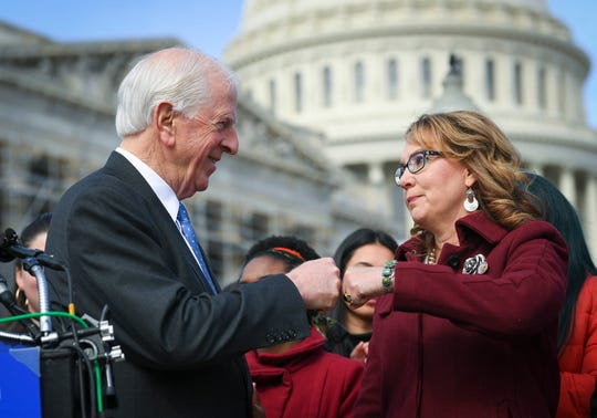 Rep. Mike Thompson, D-Calif., chairman of the House Gun Violence Prevention Task Force, fist bumps with former Rep. Gabrielle Giffords, following a press conference on Capitol Hill ahead of the vote on H.R. 8, the Bipartisan Background Checks Act of 2019.