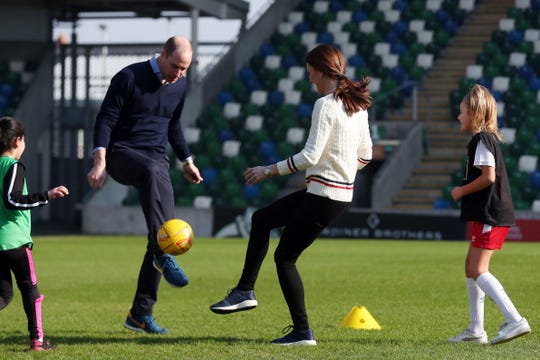 a5875ef63870c Prince William and Duchess Kate get playful at the National Stadium in  Belfast on Feb.