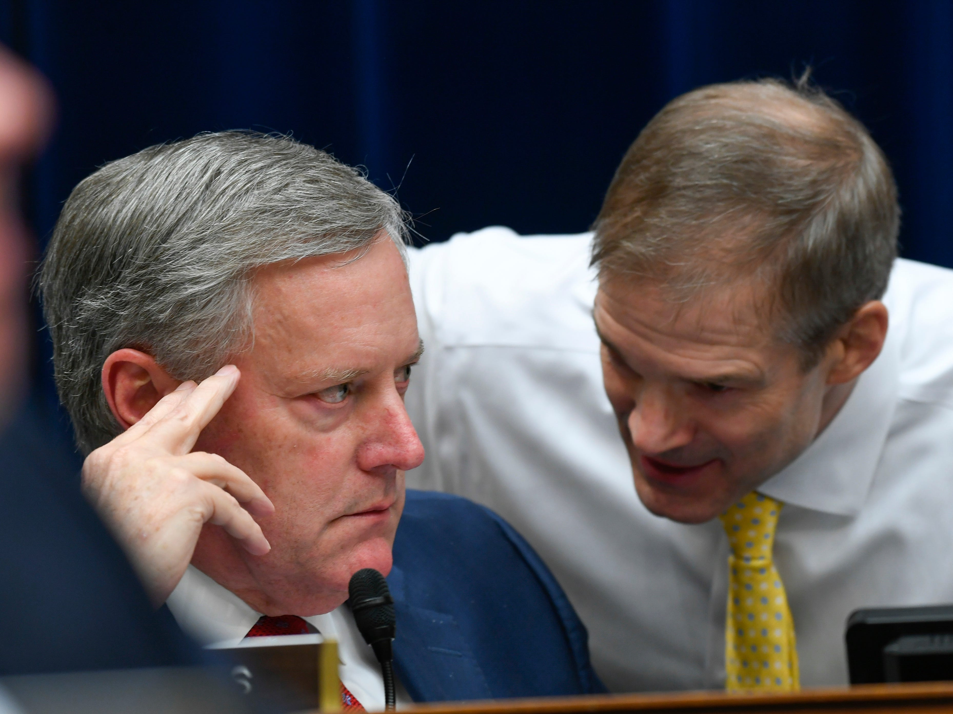 Rep. Mark Meadows (R- NC), left, listens to Rep. Jim Jordan (R-OH), the House Oversight Committee's Republican leader, following a heated exchange after remarks by Rep. Rashida Tlaib (D-MI) as she questioned Michael Cohen, President Donald Trump's longtime personal attorney, before the House Committee on Oversight and Reform on Feb. 27, 2019 in Washington.