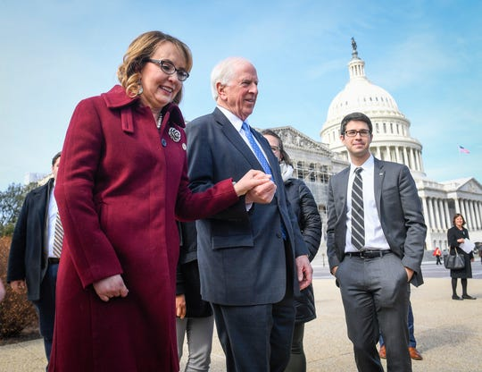 Former Rep. Gabrielle Giffords walks with Rep. Mike Thompson, D-Calif., following a news conference advocating for an expansion of background checks for gun purchases Feb. 26, 2019, in Washington, D.C.