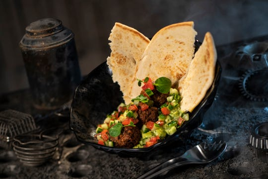 "The Felucian Garden Spread, found at Docking Bay 7 Food and Cargo, is a plant-based ""meatball"" dish with herb hummus and tomato-cucumber relish with pita bread."