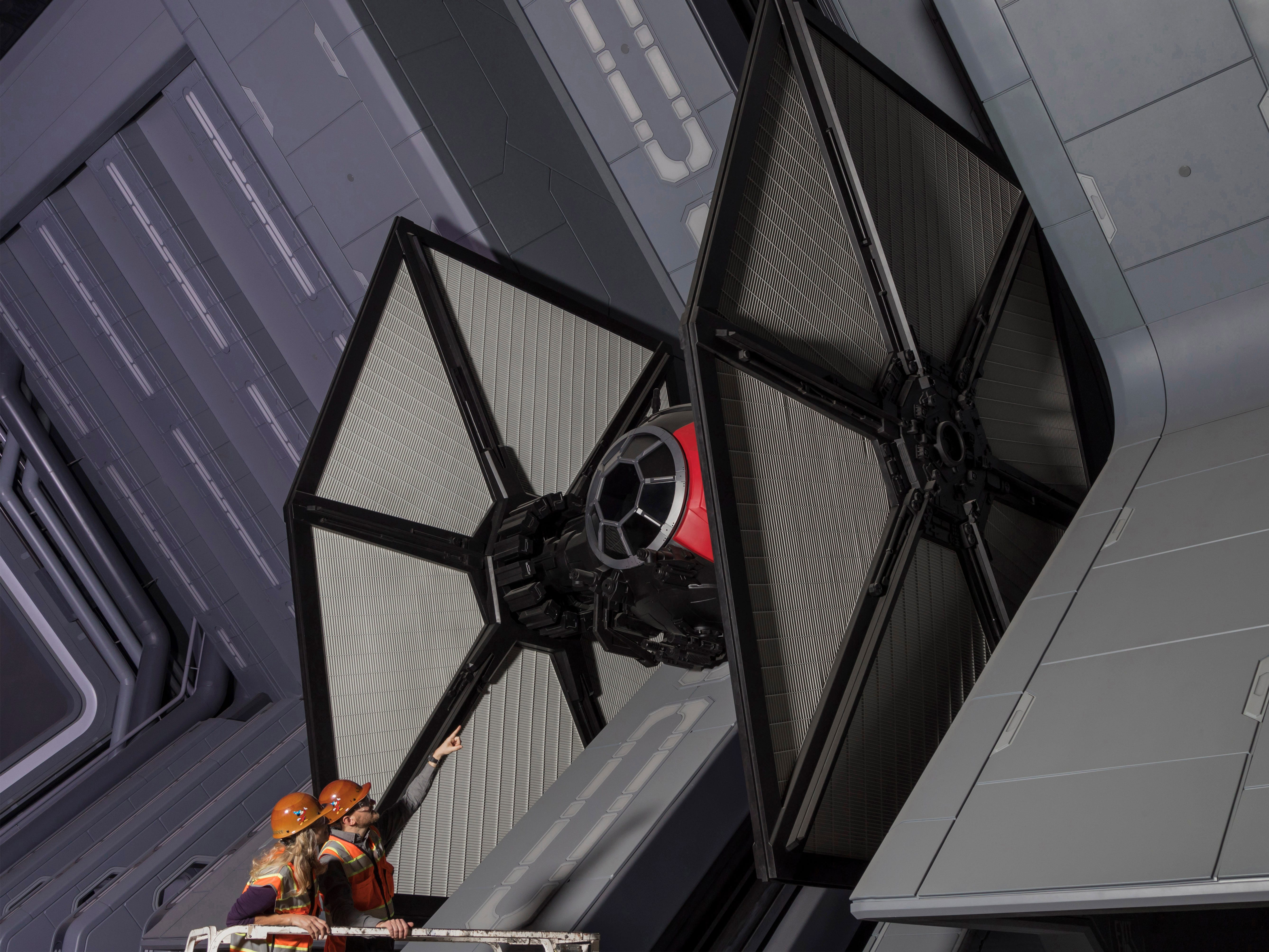 Disney Imagineers view a TIE fighter as they work on Star Wars: Rise of the Resistance at Star Wars: Galaxy's Edge, opening in summer 2019 at Disneyland Resort in California and fall 2019 at Walt Disney World Resort in Florida.