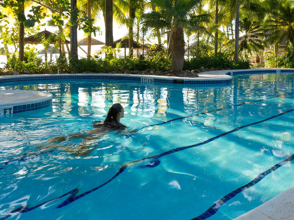 The main pool at Curtain Bluff is ideal for an aquatic class at one end, lap swims in the middle and splashing around in the shallow end.