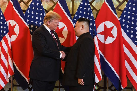 President Donald Trump shakes hands with North Korea's leader Kim Jong Un before a meeting at the Sofitel Legend Metropole hotel in Hanoi on Feb. 27, 2019.