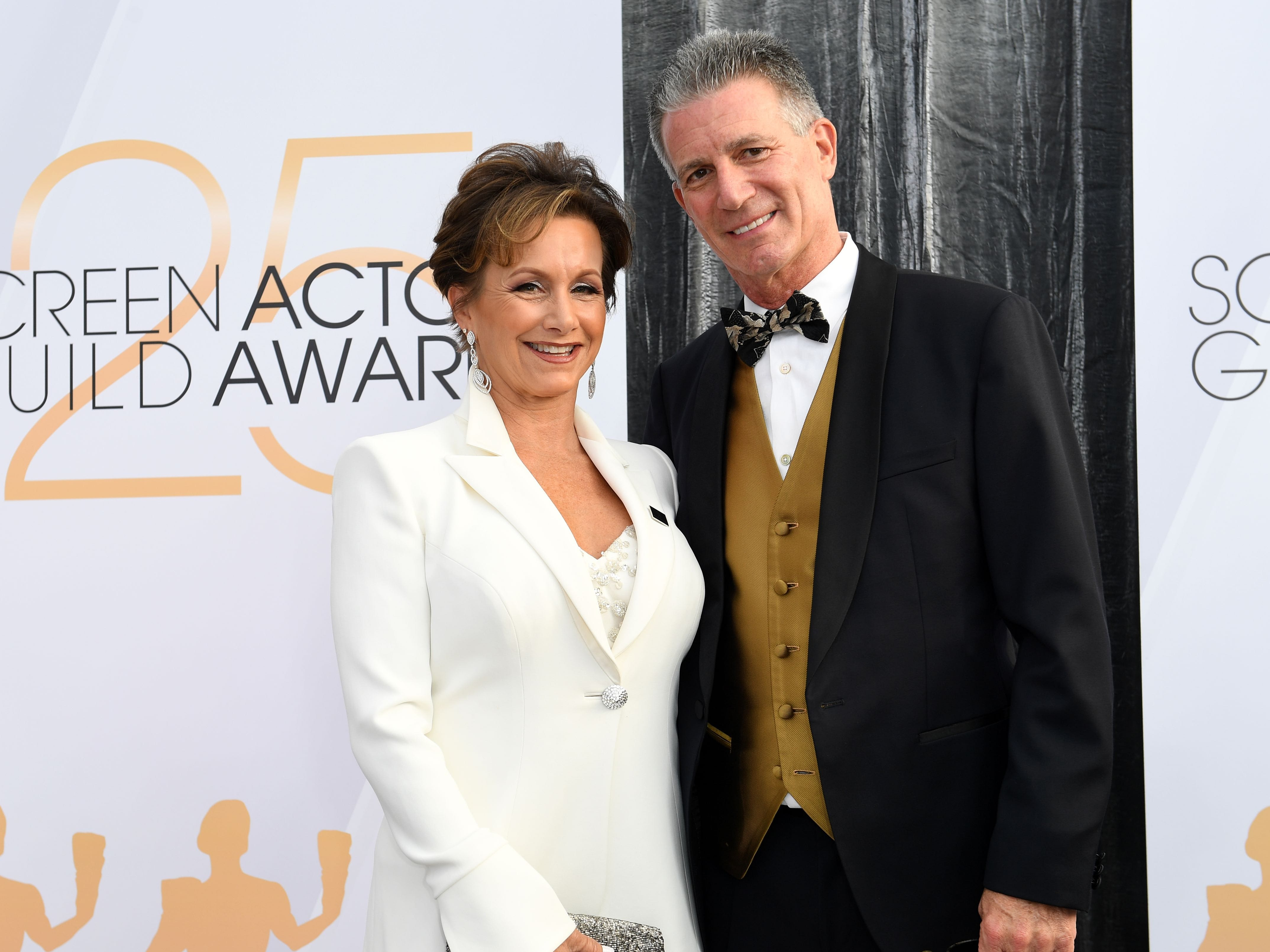 President of SAG-AFTRA Gabrielle Carteris and husband Charles Isaacs  attend the 25th Annual Screen Actors Guild Awards at The Shrine Auditorium, in Los Angeles, California, on January 27, 2019. (Photo by VALERIE MACON / AFP)VALERIE MACON/AFP/Getty Images ORG XMIT: 25th Annu ORIG FILE ID: AFP_1CR2S4