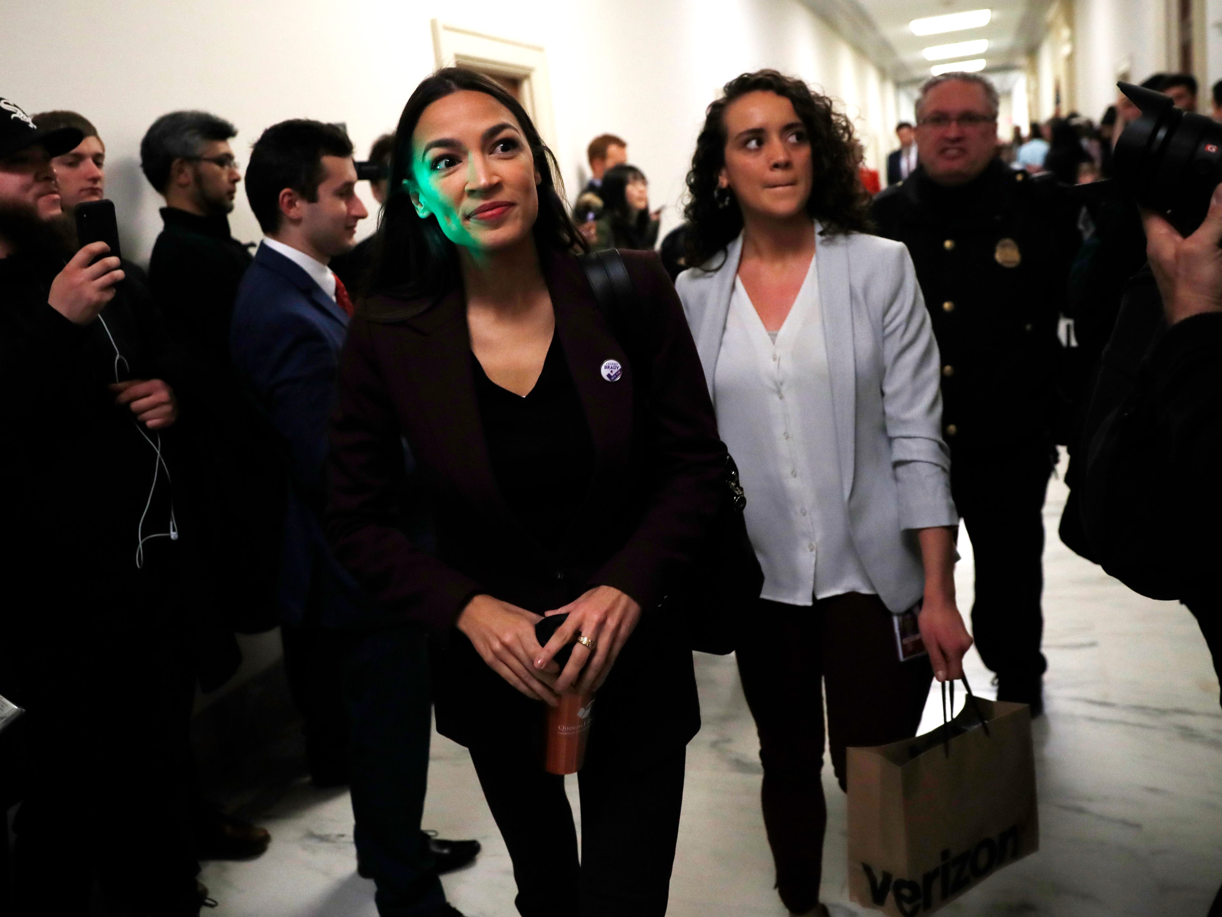 Rep. Alexandria Ocasio-Cortez, D-N.Y.,  arrives to a hearing where Michael Cohen, President Donald Trump's former personal lawyer, will testify before the House Oversight and Reform Committee on Capitol Hill in Washington, Wednesday, Feb. 27, 2019. Ocasio-Cortez sits on the committee.