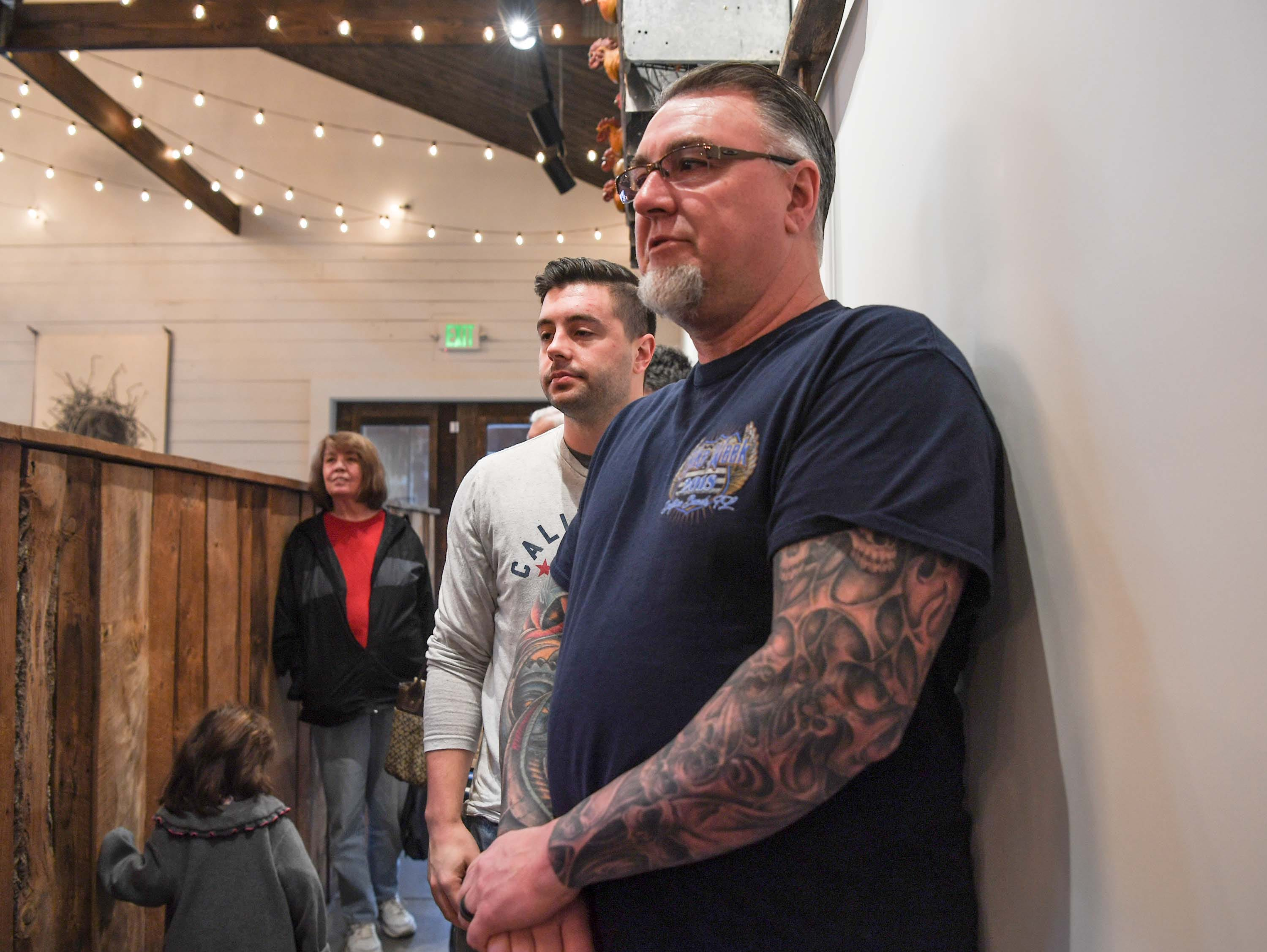 Steele Ramey, left, and his father Scott Ramey of Anderson are first in line on opening day of Smokin' Pig on Evergreen Road in Anderson Thursday, February 28, 2019. The new location is the fourth, with locations in Pendleton, Williamston, and Easley.