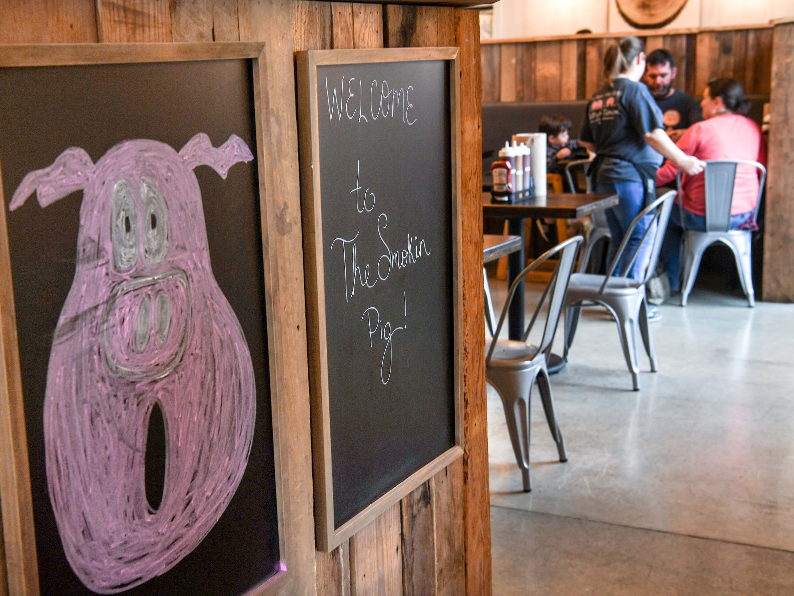 Opening day of Smokin' Pig on Evergreen Road in Anderson, order their lunch Thursday, February 28, 2019. The new location is the fourth, with locations in Pendleton, Williamston, and Easley.