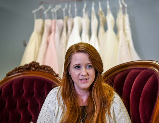 Allie Walker talks about starting her business, Katherine Marie Bridal Boutique, sitting in her store on East Greenville Street in Anderson Thursday, February 28, 2019. Walker is at the location next to the Bagel Shop until her downtown Anderson location is renovated at 106 East Benson Street, previously the Anderson School of Dance.