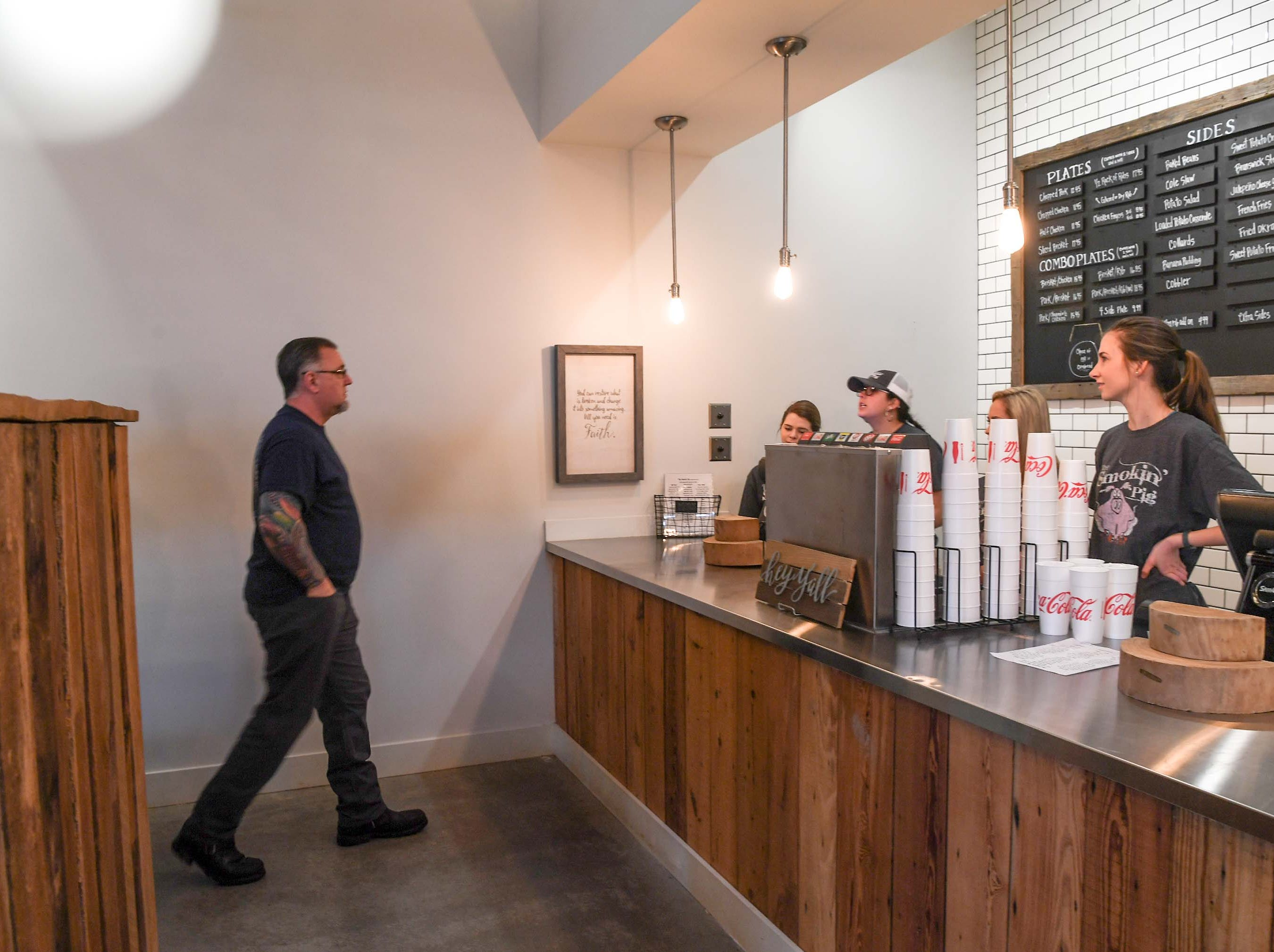 Scott Ramey of Anderson walks up to the counter, the first in line on opening day of Smokin' Pig on Evergreen Road in Anderson Thursday, February 28, 2019. The new location is the fourth, with locations in Pendleton, Williamston, and Easley.