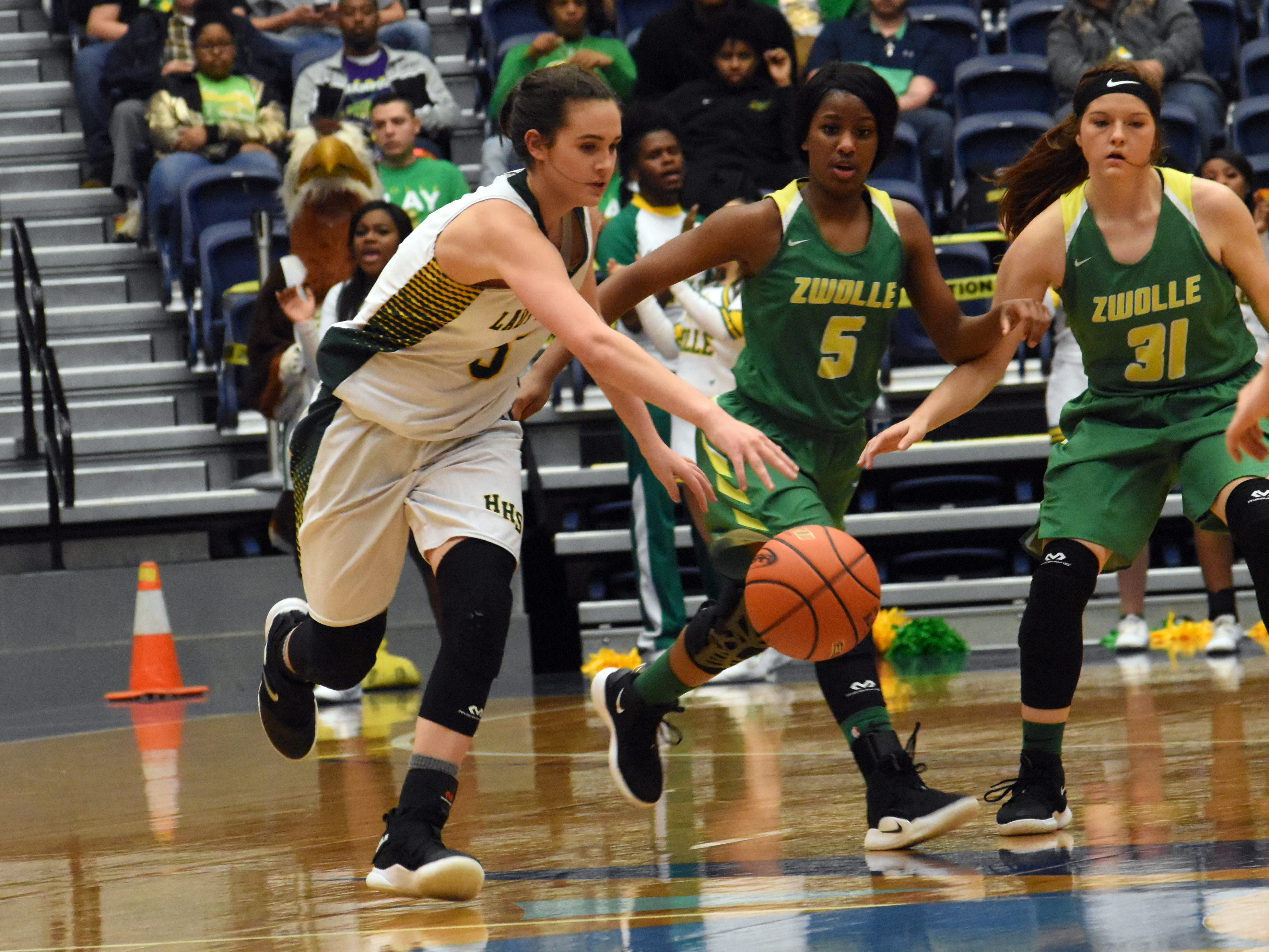 Hicks High School defeated Zwolle High School 58-49 in the semifinals of the Class B 2019 Allstate Sugar Bowl LHSAA girls' State Basketball Marsh Madness Tournament held Wednesday, Feb. 27, 2019 at the Rapides Parish Coliseum. Hicks advances to the state championship tournament against Anacoco High School.