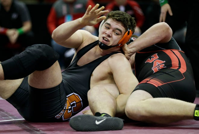 Stratford's Dylan Schoenherr, left, and his teammates will wrestle in the Division 3 state team tournament Saturday in Madison.