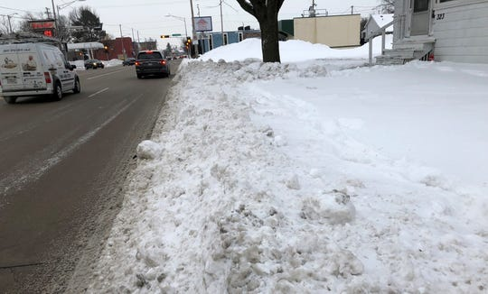 Snow and ice covers the sidewalk in the 300 block of North Richmond Street in Appleton.