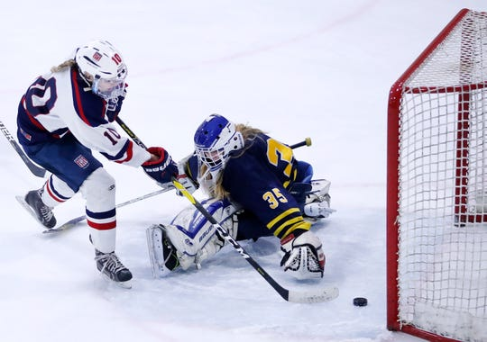 Maddy Jablonski of the Fox Cities Stars scores on goalie Sami Stommel of University School of Milwaukee during their sectional semifinal game Feb. 19 at Tri-County Ice Arena.