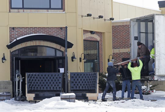 Workers remove furniture from the former Parma restaurant in Grand Chute. The location, 3775 W. College Ave., is the future site of a Chick-fil-A restaurant.