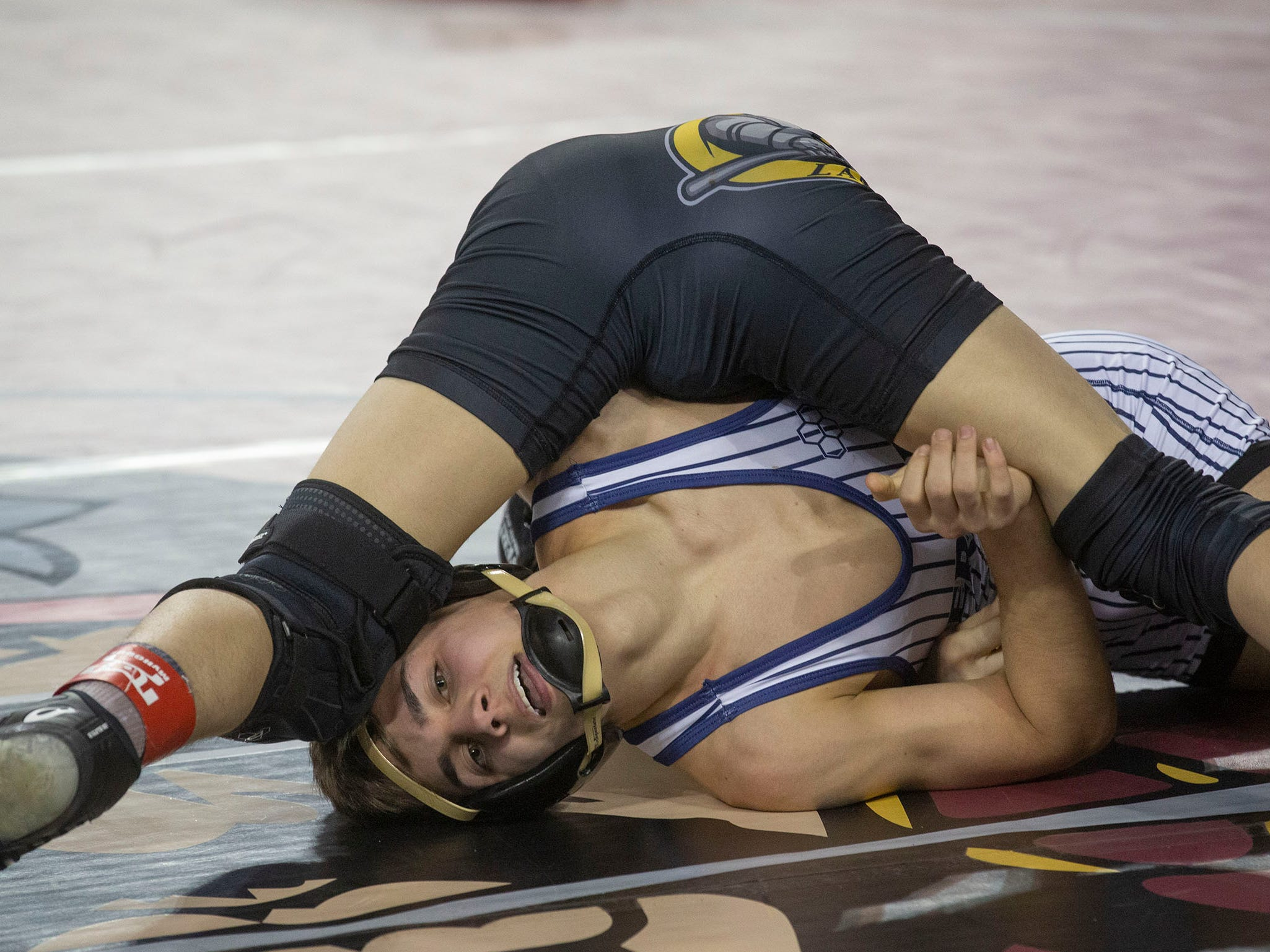 St. John Vianney's Dean Peterson gets back points against  St. Augustine Prep's  D'Amani Almodovar in their 113. lbs. bout.  NJSIAA State Wrestling opening rounds in Atlantic City, Thursday February 28, 2019