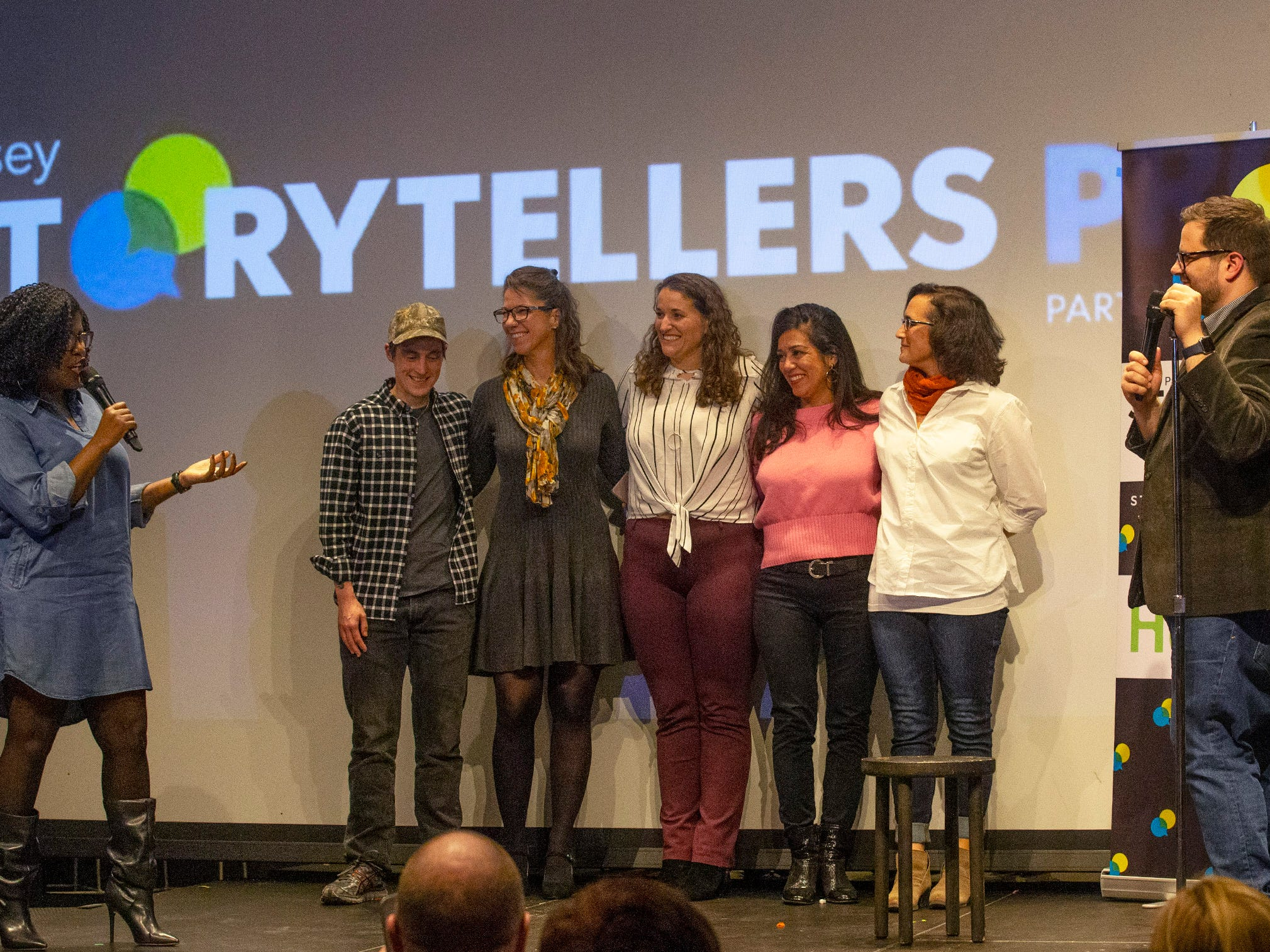 Speakers take a bow  as the show draws to to close - l to r -Host G. Michelle Lewis, Dillan DiGiovanni, Michelle A Mulkerin, Susanne Cervenka, Cynthia Salinas,  Mona Soliman and host Mike Davis Speakers and crowds alike enjoy the latest version of Storytellers in Asbury Park on February 27, 2019, this night's subject was starting over.