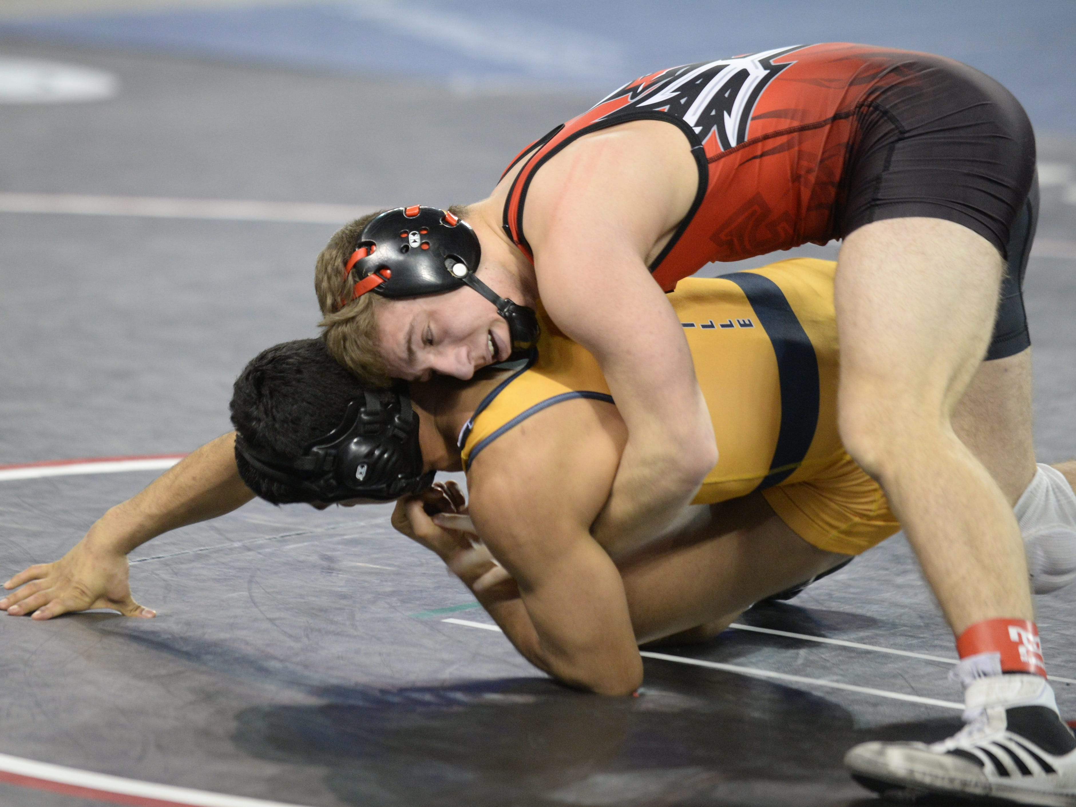 Hunterdon Central's Pasquale Vizzoni wrestles Belleville's David Guerra in a 145-pound first round bout during the NJSIAA Individual Wrestling Championships at Boardwalk Hall in Atlantic City, Thursday, Feb. 28, 2019.