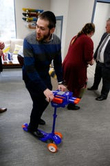 Flybar President & CEO Saul Wolhendler rides a Nerf scooter at the company's Howell Township office Wednesday, February 27, 2019.   Flybar is the original pogo stick company and has moved its operations to Howell.