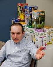 Sergio Godinho, vice president of business strategy, speaks about Flybar's products at the company's Howell Township office Wednesday, February 27, 2019.   Flybar is the original pogo stick company and has moved its operations to the township.