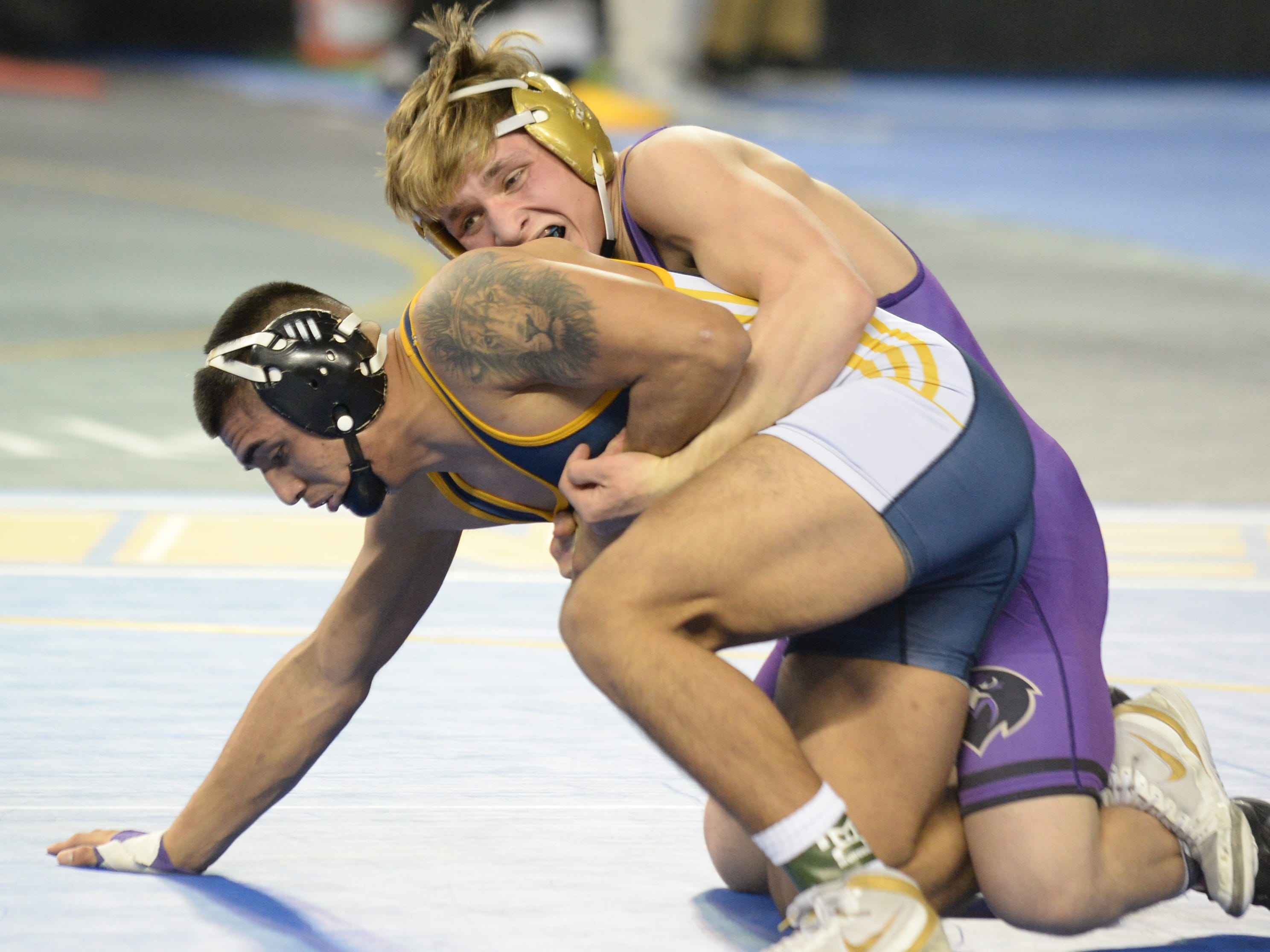 Monroe's Ian McCabe wrestles Nottingham's Jerry Andaluz in a 152-pound first round bout during the NJSIAA Individual Wrestling Championships at Boardwalk Hall in Atlantic City, Thursday, Feb. 28, 2019.