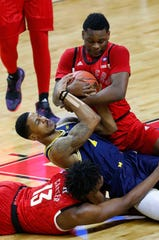Rutgers Scarlet Knights guard Montez Mathis (23) battles Michigan Wolverines guard Charles Matthews (1) for the ball at the RAC.