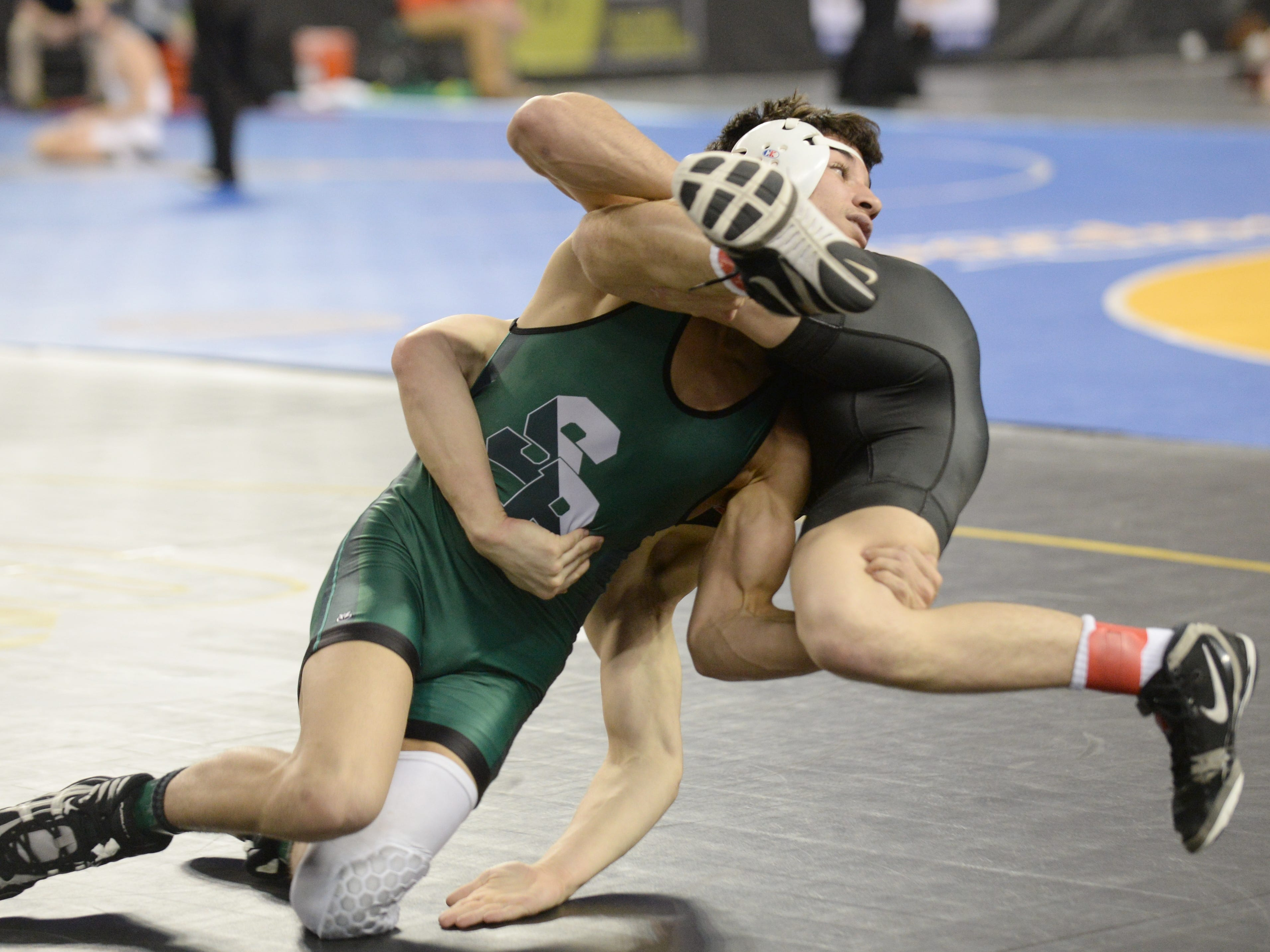 South Plainfield's Tommy Fierro takes down Kingsway's Finnegan McFadden in a 132-pound first round bout during the NJSIAA Individual Wrestling Championships at Boardwalk Hall in Atlantic City, Thursday, Feb. 28, 2019.