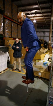 Derrick K. Benns, Regional Director Business Development for the NJ Economic Development Authority, takes a bounce on Flybar's 'Super Pogo'™ at the company's Howell Township warehouse Wednesday, February 27, 2019.   Flybar is the original pogo stick company and has moved its operations to Howell.