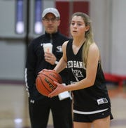 Red Bank Regional girls basketball coach John Truhan watches sophomore Caitlyn Decker during practice Wednesday, February 27, 2019.